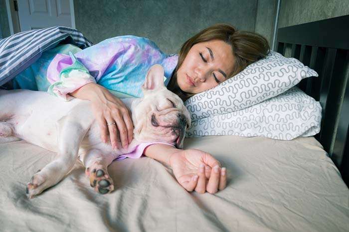 Woman sleep with dog